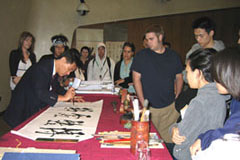 San-pao Li Demonstrating Calligraphy