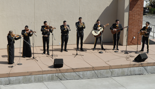 Director Cynthia Flores, Erica Rodriguez, Efrain Andrade, Roberto Mendez, Miguel Salgado, Juan Cuevas, Manuel Sandoval, and Angel Juarez perform mariachi music on the USU outdoor stage Tuesday 10 March 2009.