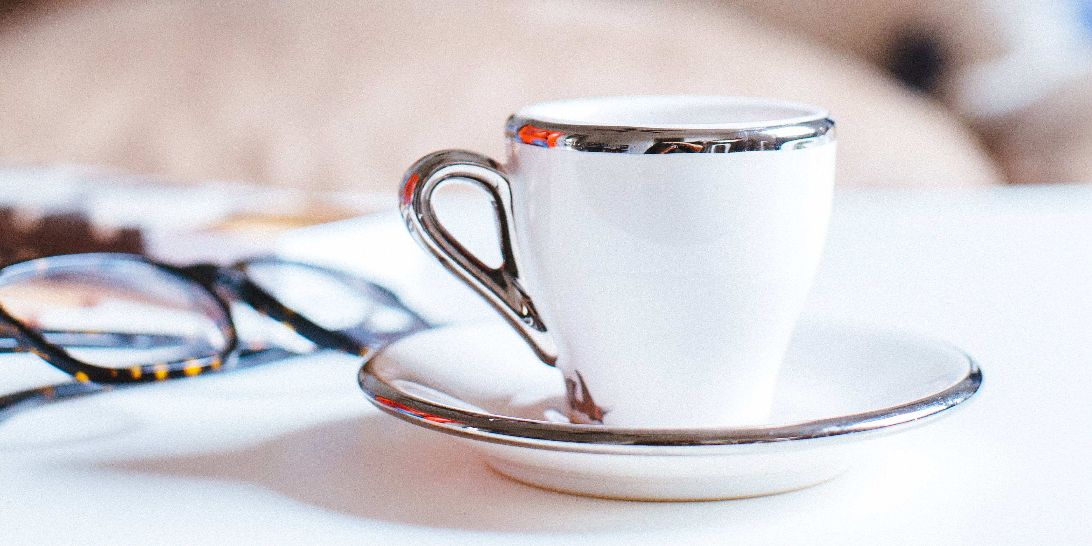 Cup of coffee and saucer on a table