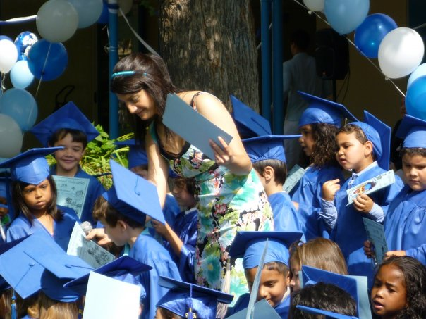 Liberal Studies alumnus Angineh Bandari (Class of 2006) with her Kindergarten class.