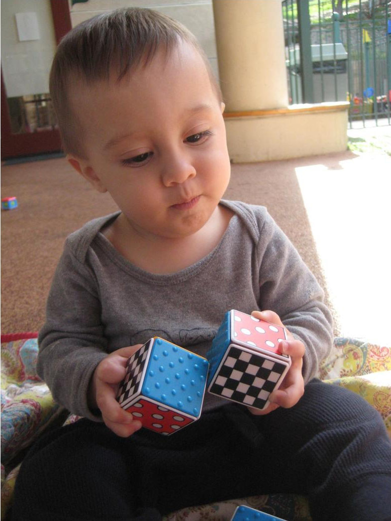 Picture of child with blocks