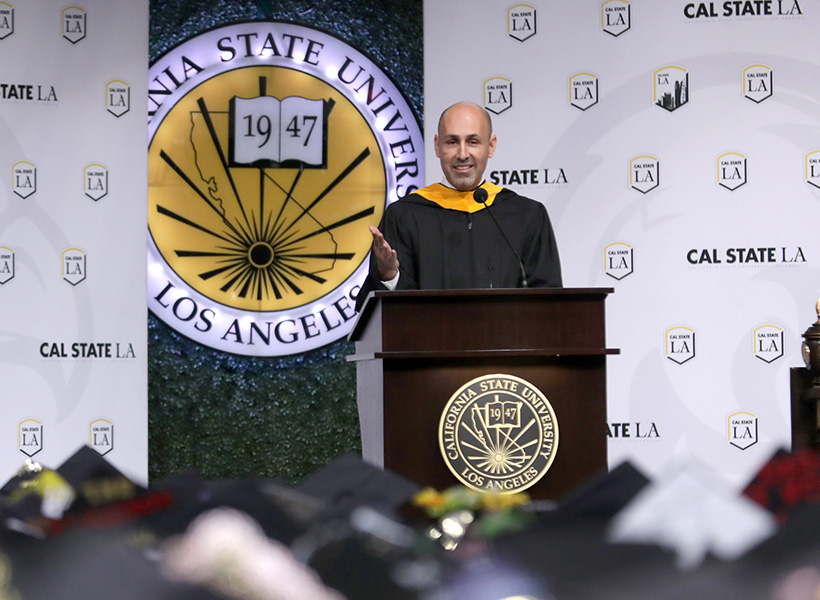 Jorge Orozco speaks to graduating students at Commencement 2019.