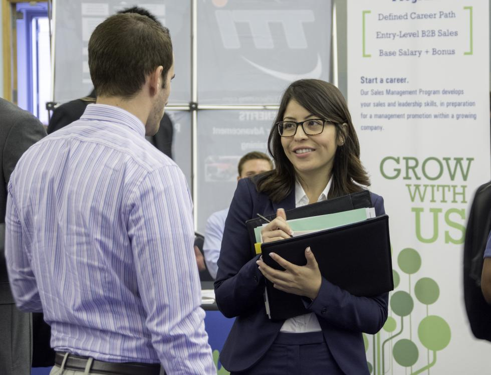 Student speaking with employer at career fair