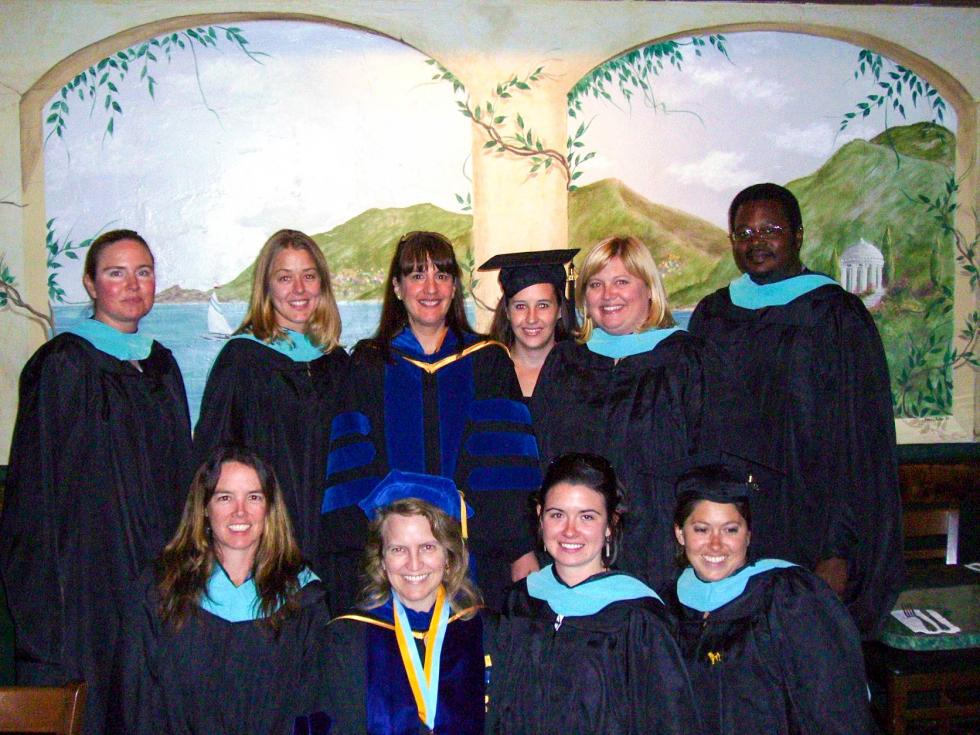 Cal State LA O&M students celebrate 2007 commencement with faculty back row: Nancy Warsham, Kristey Ulley, Brenda Naimy (faculty), Jennifer Freeman, Lisa Fischenger, Jonathan Kelley. front row: Kelly Wynne, Diane Fazzi (program coordinator), Rachel Schepperly, Michelle Holbrook