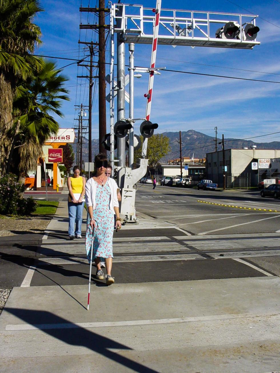 2002 Cal State LA O&M students practice safe railroad crossings – pictured: Viki Kirin with the long cane and Angie Crabtree in background.