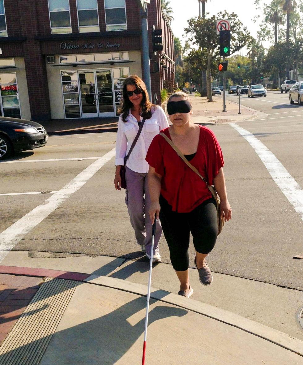 Brenda Naimy, program faculty, supervises  2015 Cal State LA O&M alum, Karmela Yahyakashani as she clears the upcurb to step up on the corner