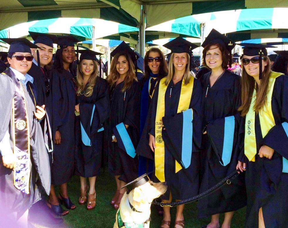 Cal State LA 2013 O&M Cohorts at Spring Commencement with faculty (from left to right) - Judy Luu, Cesar Guzman, Renah Jones, Blanca Trujillo, Alexis Rettig, Brenda Naimy (faculty), Erin Brahe, Dana La Curan, and Amanda Jones