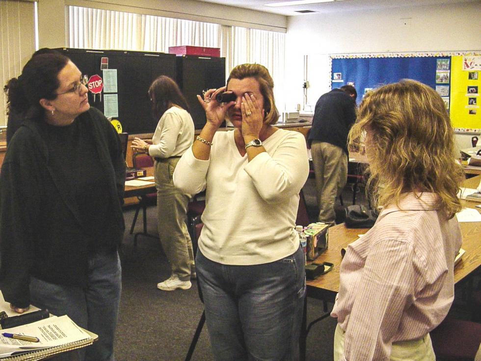 Diane Fazzi, O&M Program Coordinator works with Cal State LA O&M students on monocular usage for students who have low vision – (from left to right) Bridget Doherty, Carrie Gonzales, and Diane Fazzi