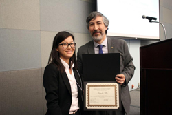 Graduate ME Student Angela Wu receives an award for her research in heat exchangers.