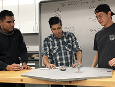 Students designing a gyroscope in engineering lab