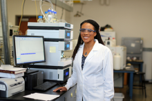Dr. Krishna Foster standing in her lab.