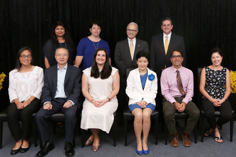 Six Outstanding Professor Awardees seated with four administrators standing behind