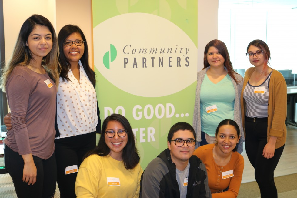 SEEDs scholars in front of Community Partners banner