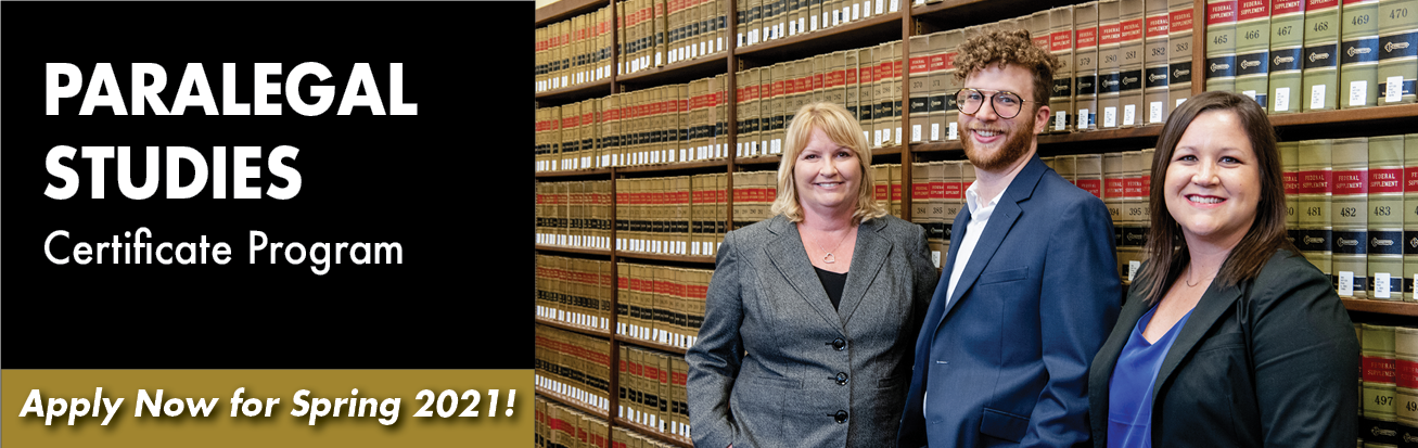 Three legal professionals (two women and one man) stand in front of legal books at LA Law Library.