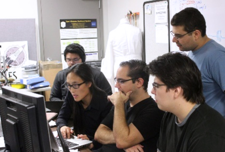 Four graduate students work together on electrical engineering project with Cal State LA Faculty member