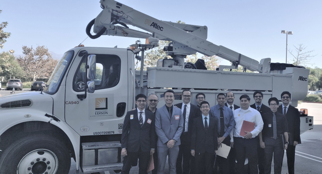 Group of Cal State LA Electrical Engineering Students and faculty pose in front of So Cal Edison truck