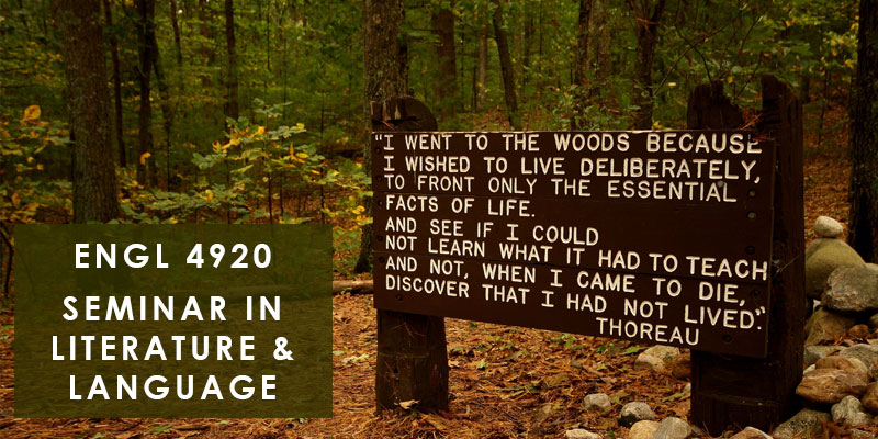wooden sign with Thoreau quote in forest