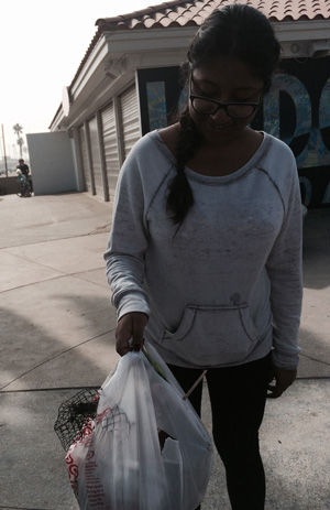 "CSULA Student with some of the ""harvest"" at beach clean-up"