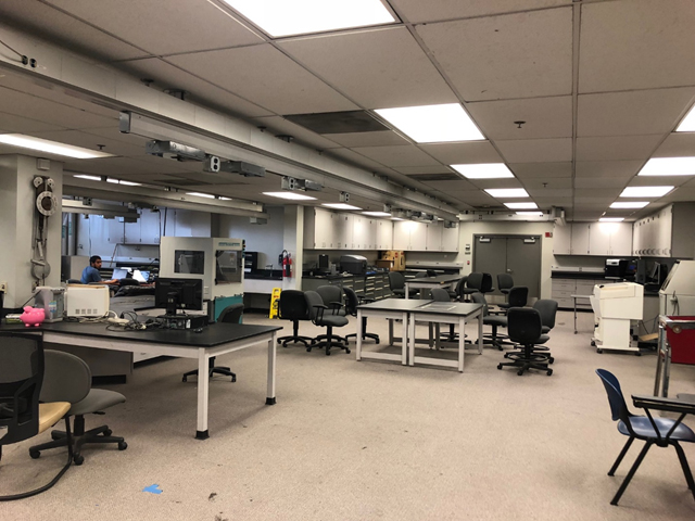 Interior of Automated Manufacturing Lab with one student working in the distance