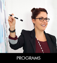 Programs Link- Female Instructor at Board