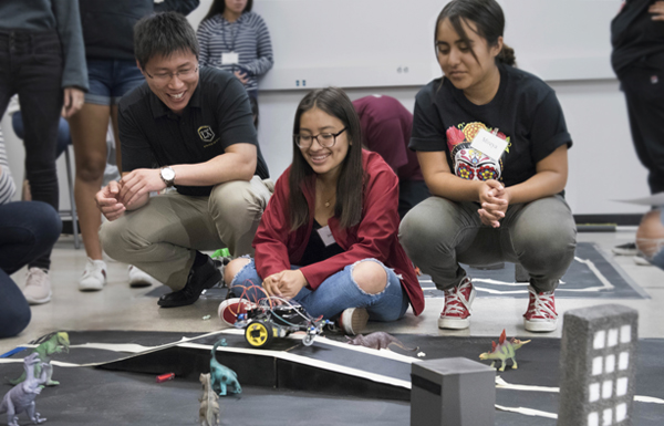LaunchPad participants build a robot with a Cal State LA Professor