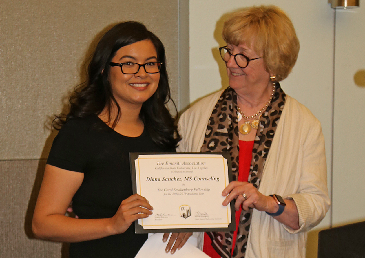 Diana Sanchez, student, with professor presenting award
