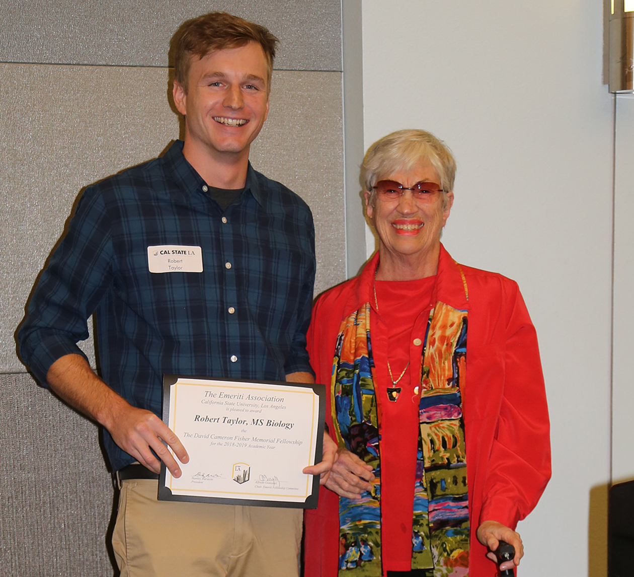 Robert Taylor, student, with professor presenting award