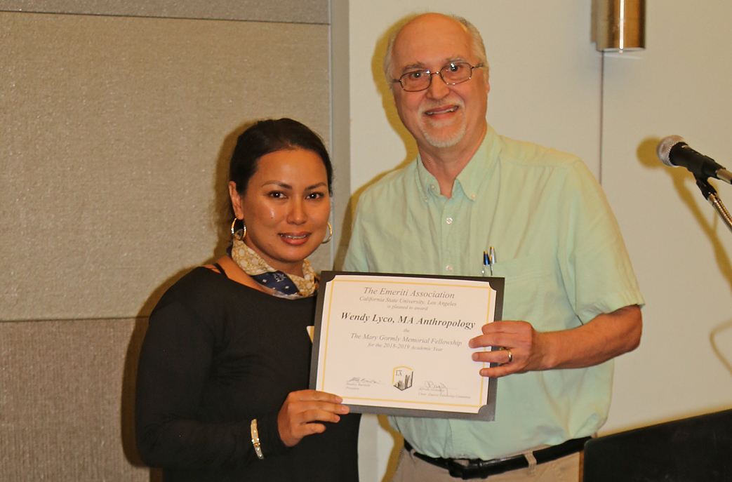 Wendy Lyco, student, with professor presenting award