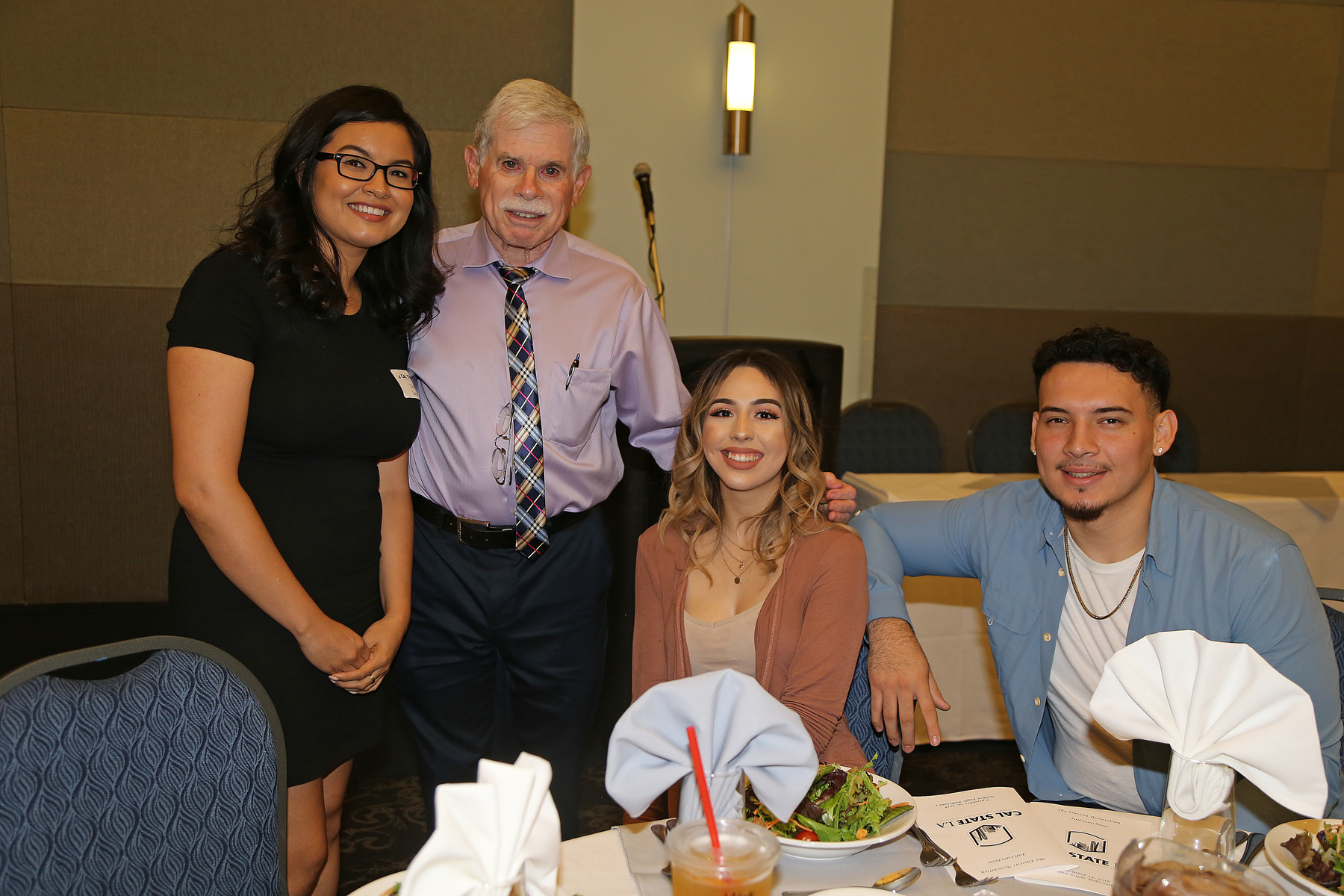 three students with professor at Fall 2017 luncheon