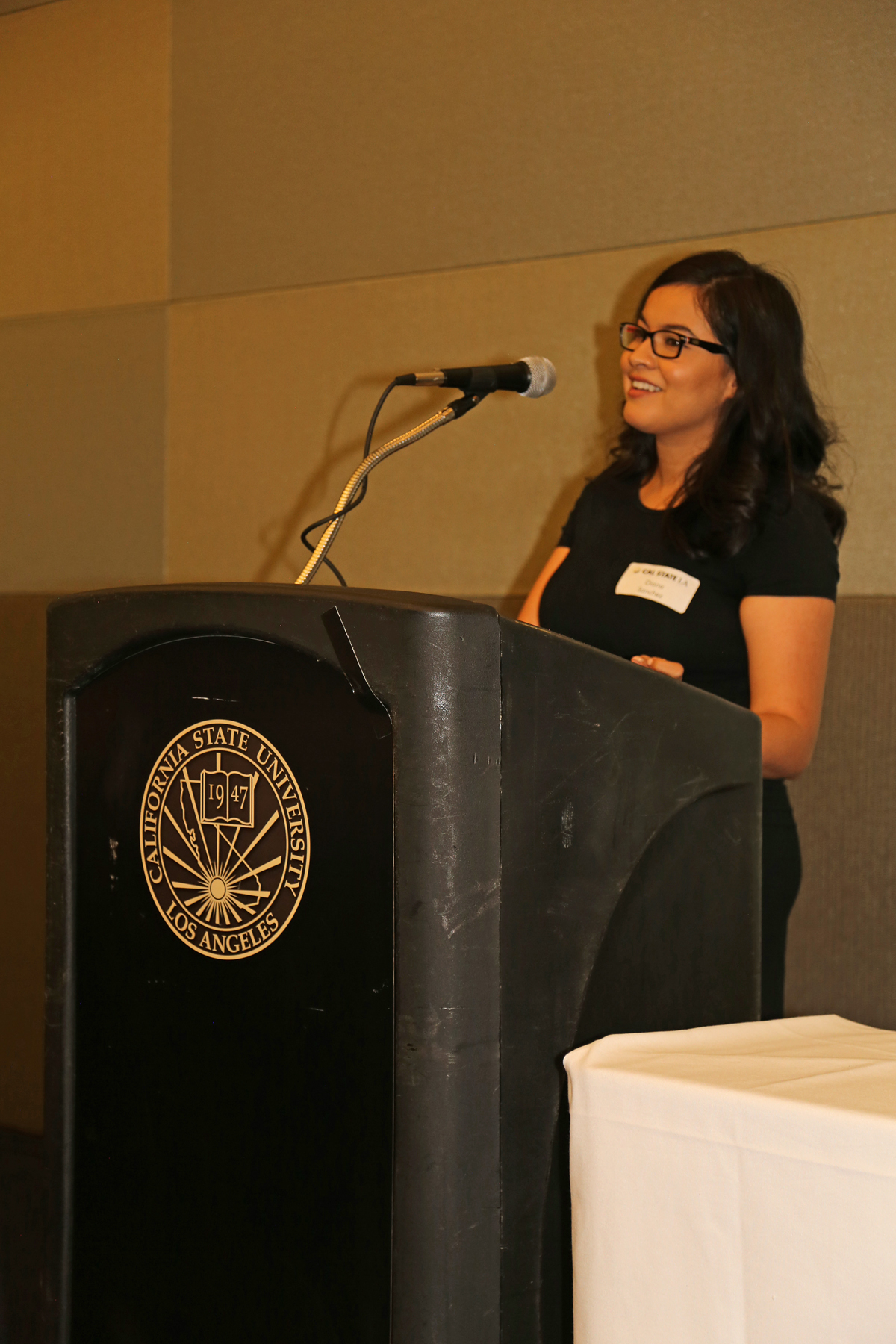 Female Student at podium at fall luncheon