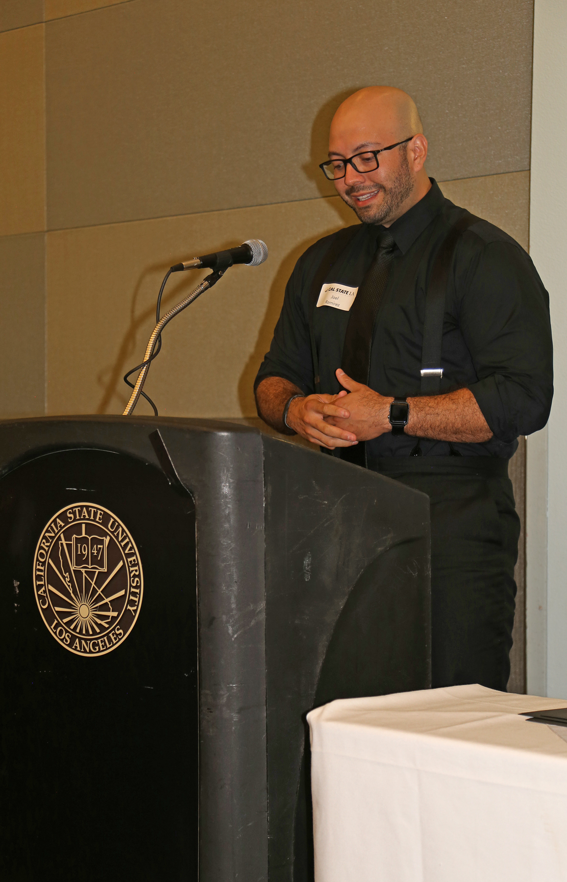 Male Student at podium at fall luncheon