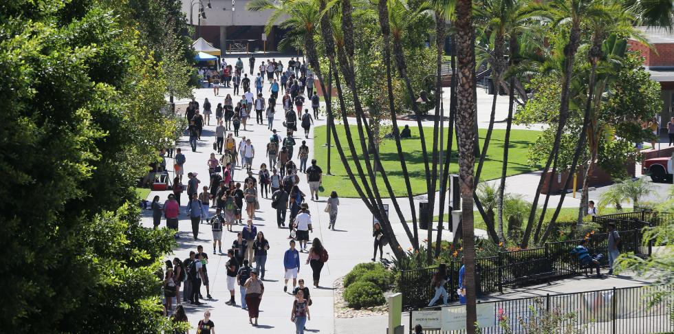 View from distance of students walking down main walkway at Cal State LA