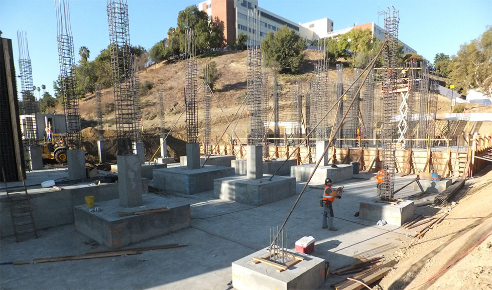 Construction workers continue to work on the new foundation and pillars.