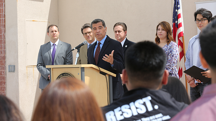 California Attorney General Xavier Becerra holds a news conference at Cal State LA