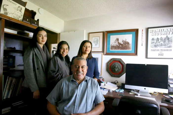 DACA recipients Citlalli Ortiz, Mayra Garibo and Lidieth Arevalo pose with Cal State Long Beach Professor Armando Vazquez-Ramos at the California-Mexico Studies Center in Long Beach on Dec. 26, 2018. Ortiz studies at Cal State Long Beach, Garibo studies at Cal State Dominguez Hills, and Arevalo is a graduate student at Chapman University. (Photo by Ana P. Garcia, Contributing Photographer)