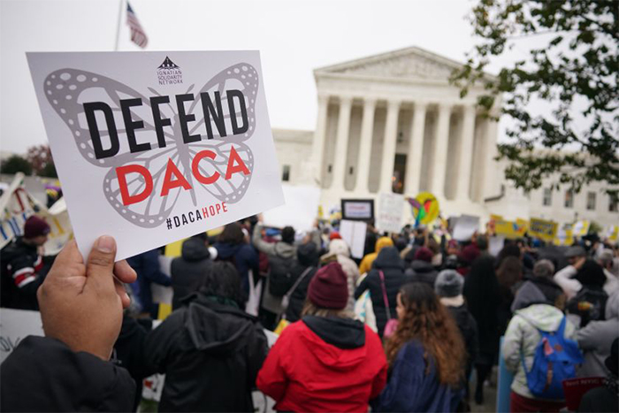 Defend DACA protest sign in front of Supreme Court building