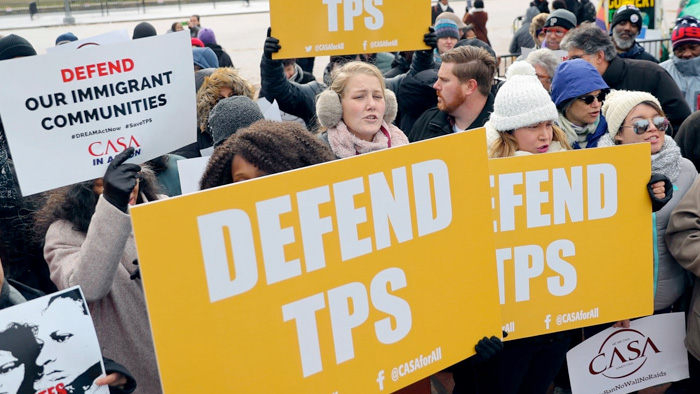 Protestors in support of TPS
