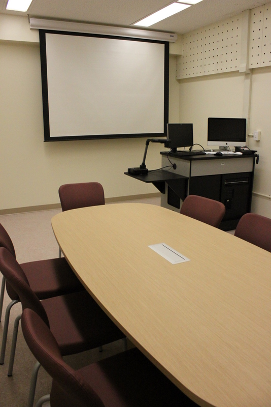 Students should be seated at the conference table