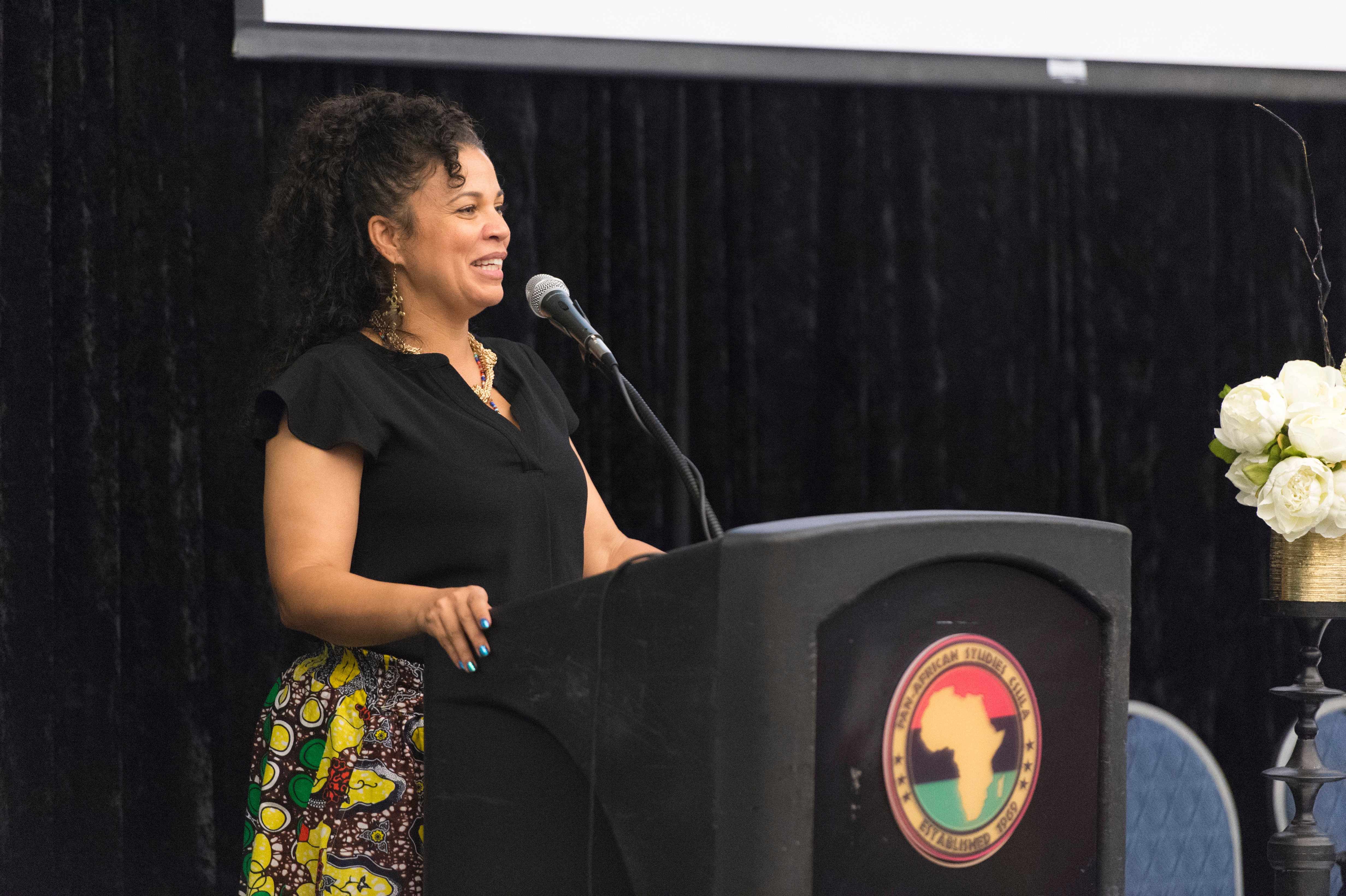 Melina Abdullah speaks at the event
