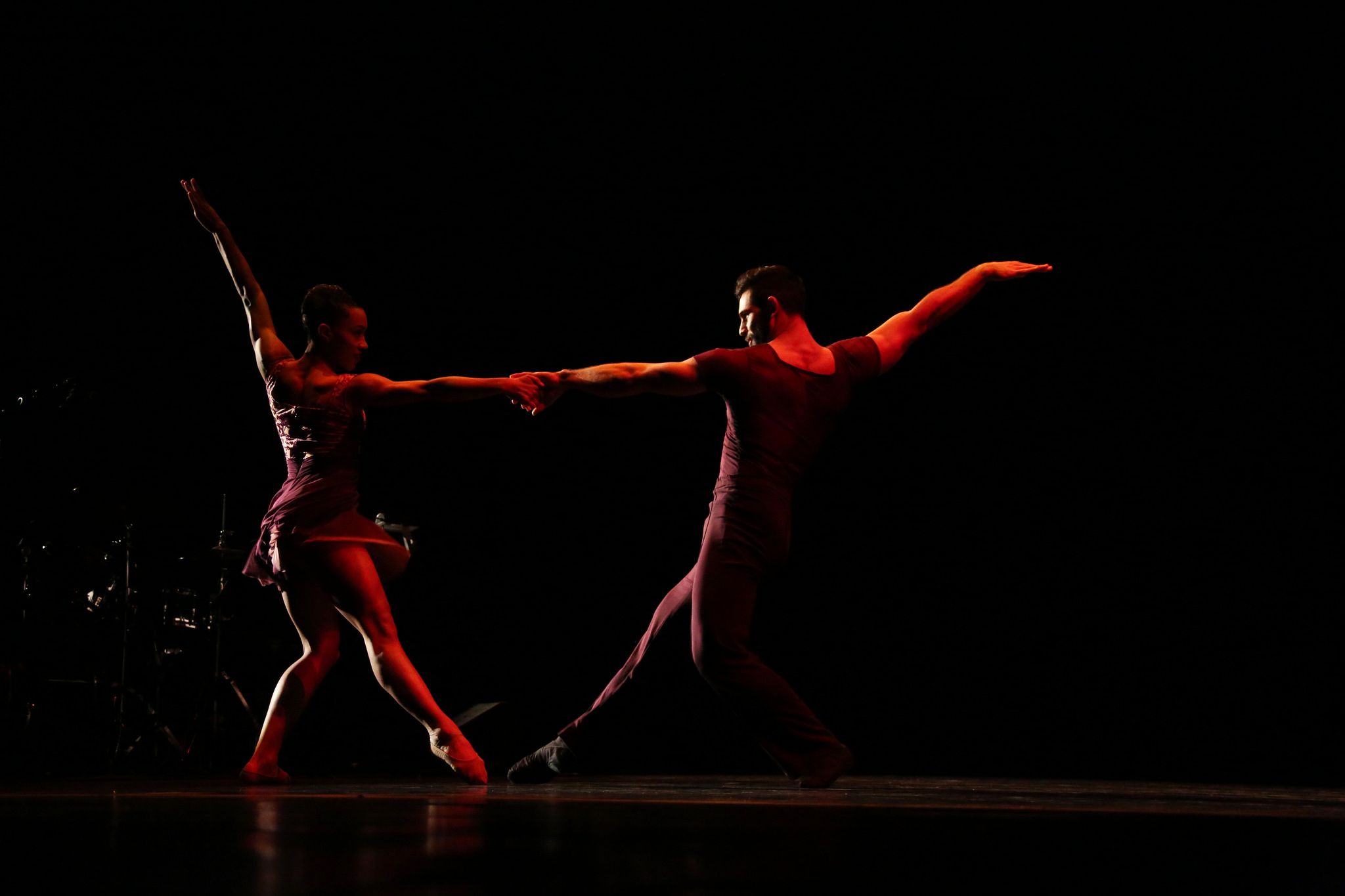 Dancers from Ballet Hispánico perform a duet onstage.