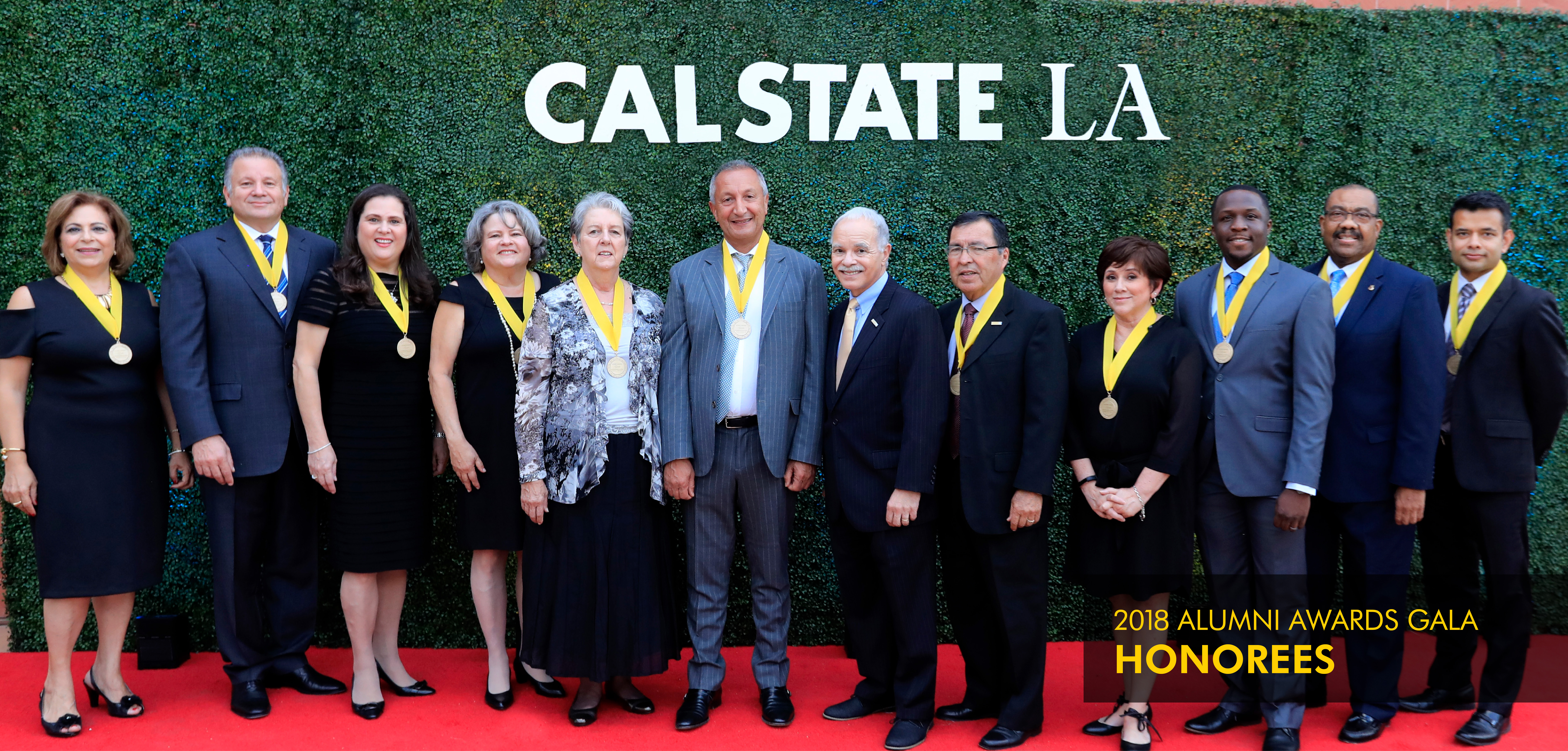 Group of Alumni Awards Gala honorees with President Covino