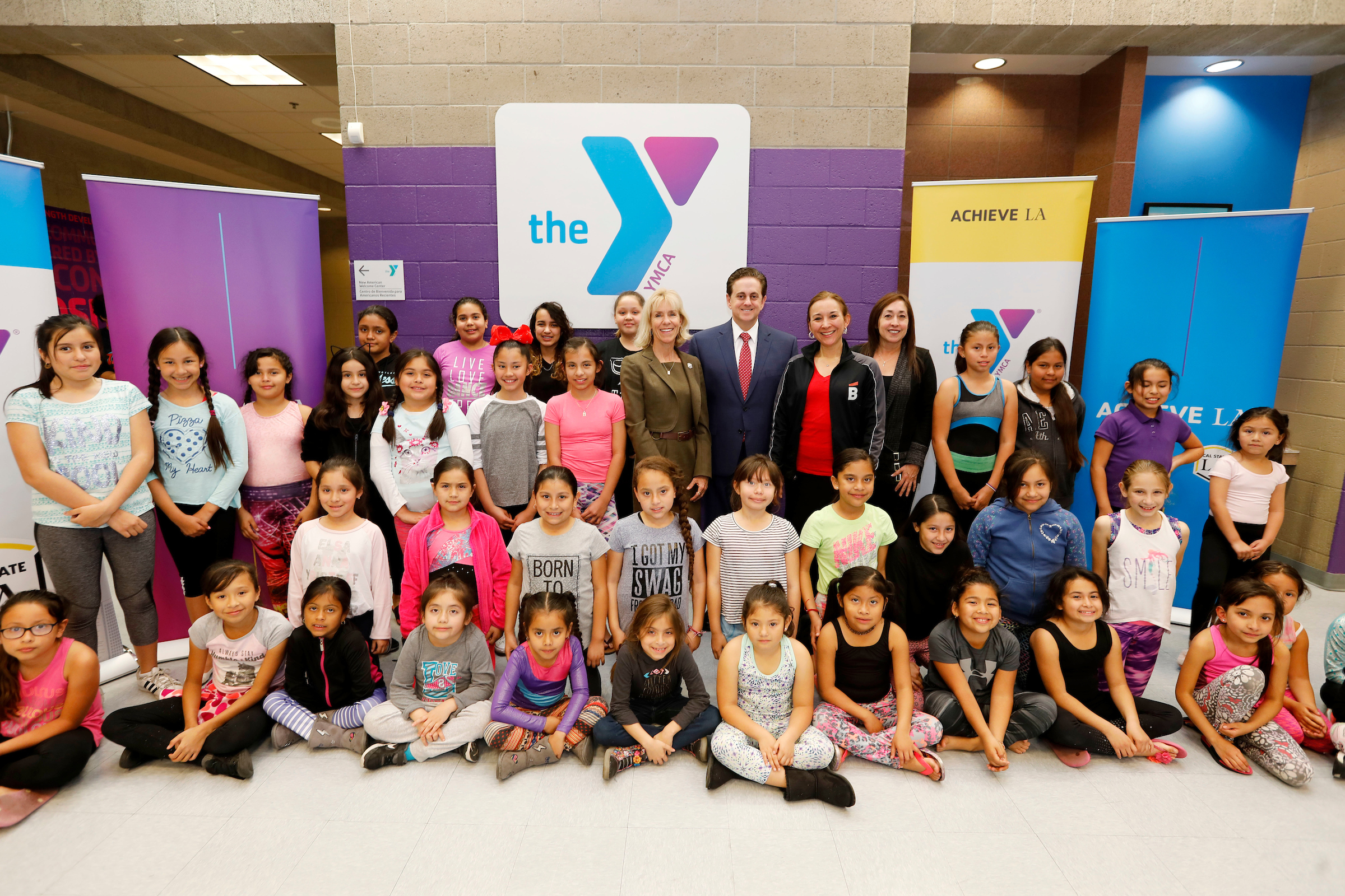 Cal State LA Vice President for Advancement Janet S. Dial, Cal State LA Executive Vice President Jose A. Gomez, Ballet Hispánico's Gabriela Estrada and Southeast-Rio Vista YMCA Executive Director Patricia Renteria with children at the dance workshop