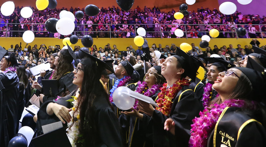 Students stand with pride and jubilation at Cal State LA's 2018 Commencement ceremony
