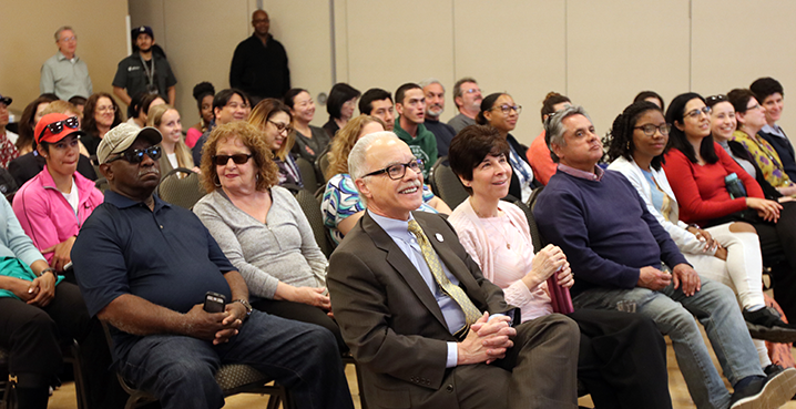President Covino and First Lady listens to Mind Matters lecture.