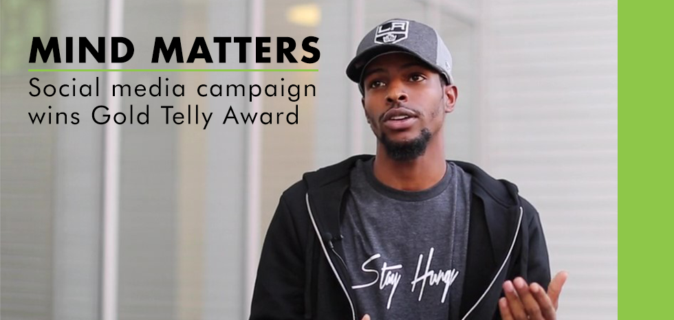 Mind Matters social media campaign wins Gold Telly Award; student speaking outdoors