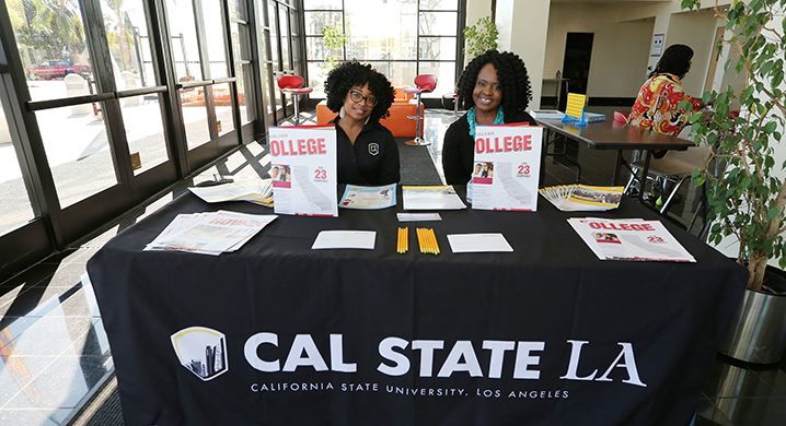 Cal State LA recruitment outreach staff at a table for Super Sunday