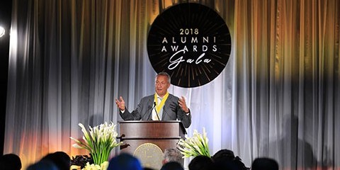 Person speaks at podium at 2018 Alumni Awards Gala