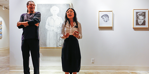 Exhibition curator Mark Steven Greenfield and Professor Mika Cho, director of the Fine Arts Gallery, next to several Kent Twitchell sketches.