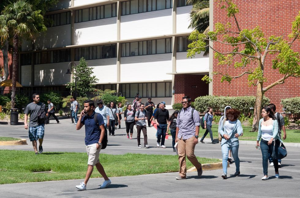 Students walking in front of Fine Arts building