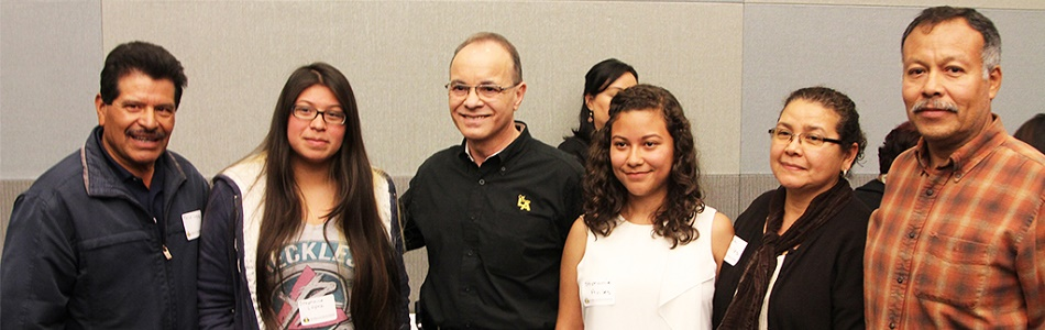 Parents and students with President Covino